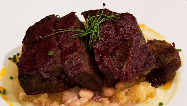 Boneless Braised BBQ short Ribs - with roasted garlic & rutabaga mash, smoky cannellini beans, leek sauce, maple syrup infused barbeque sauce.