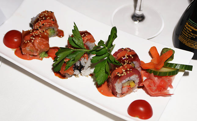 White tuna with avocado crunch, tuna/salmon roll and more in a sweet and sour sauce...