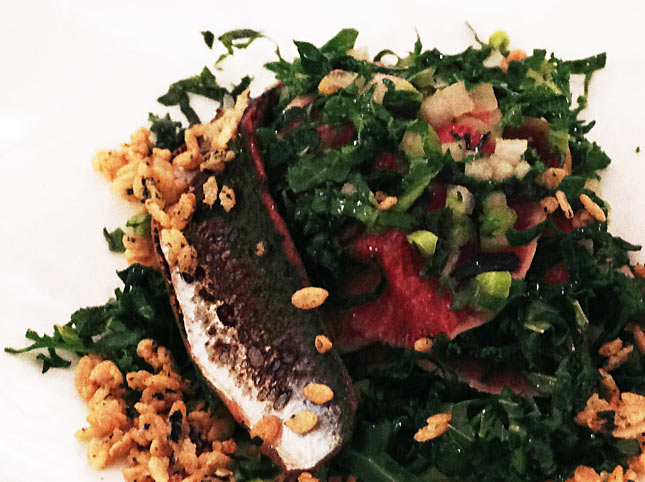 Kale Salad with crispy rice, watermelon, red herring, watermelon, radish and lime dressing.